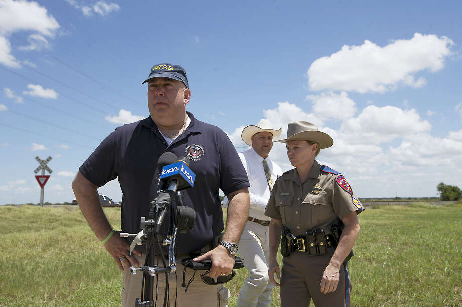 "National Transportation Safety Board Senior Advisor Erik Grosof, left, Caldwell County Sheriff Daniel Law and Texas DPS Trooper Robbie Barrera, right, leave the scene of a hot air balloon disaster Saturday, July 30, 2016, near Lockhart, Texas, causing what authorities described as a ""significant loss of life."" Photo: Ralph Barrera/Austin American-Statesman Via AP    / American-Statesman"