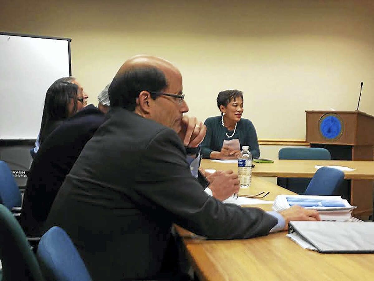 (Brian Zahn - New Haven Register) Robert Rader, executive director of Connecticut Association of Boards of Education, in the foreground and Mayor Toni Harp, in the background, sit in on the first committee meeting for a superintendent search committee.