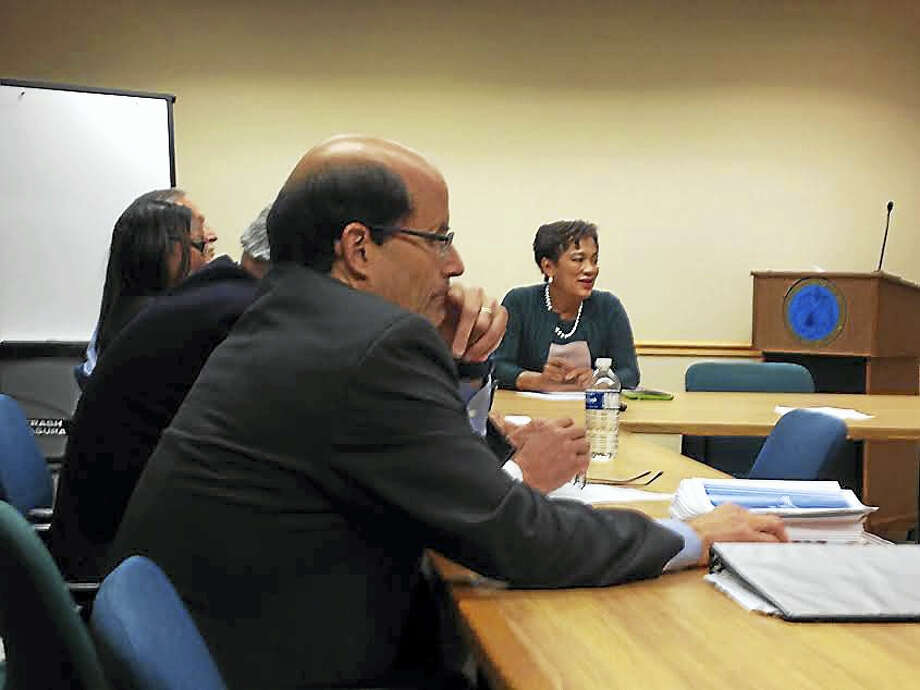 (Brian Zahn - New Haven Register) Robert Rader, executive director of Connecticut Association of Boards of Education, in the foreground and Mayor Toni Harp, in the background, sit in on the first committee meeting for a superintendent search committee. Photo: Journal Register Co.