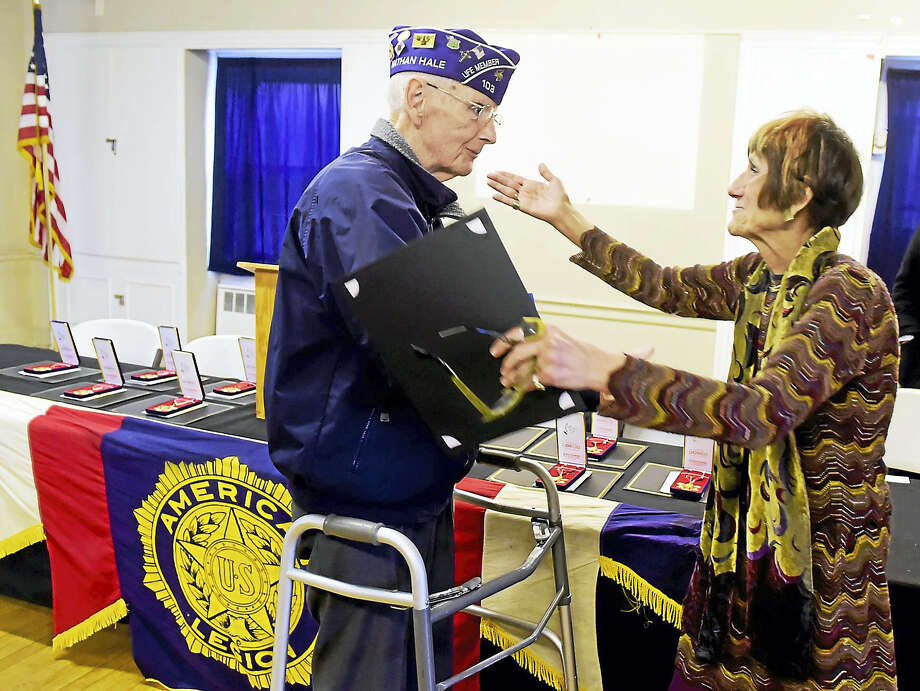 U.S. Rep. Rosa L. DeLauro honored former New Haven Police Chief William Farrell of New Haven, who served as sergeant in the Marine Corps 1st Marine Division and was wounded in combat twice and awarded two Purple Hearts, and 9 other local Korean War veterans with the Medal of Gratitude for service during the Korean War. The medals were awarded in a ceremony Thursday at the West Haven American Legion Post 71. Photo: Peter Hvizdak — New Haven Register   / ©2016 Peter Hvizdak