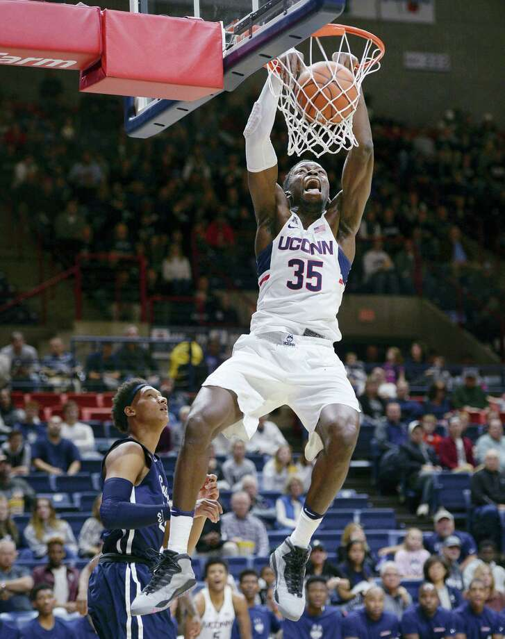 UConn's Amida Brimah dunks the ball against SCSU on Saturday. Photo: Jessica Hill — The Associated Press   / AP2016