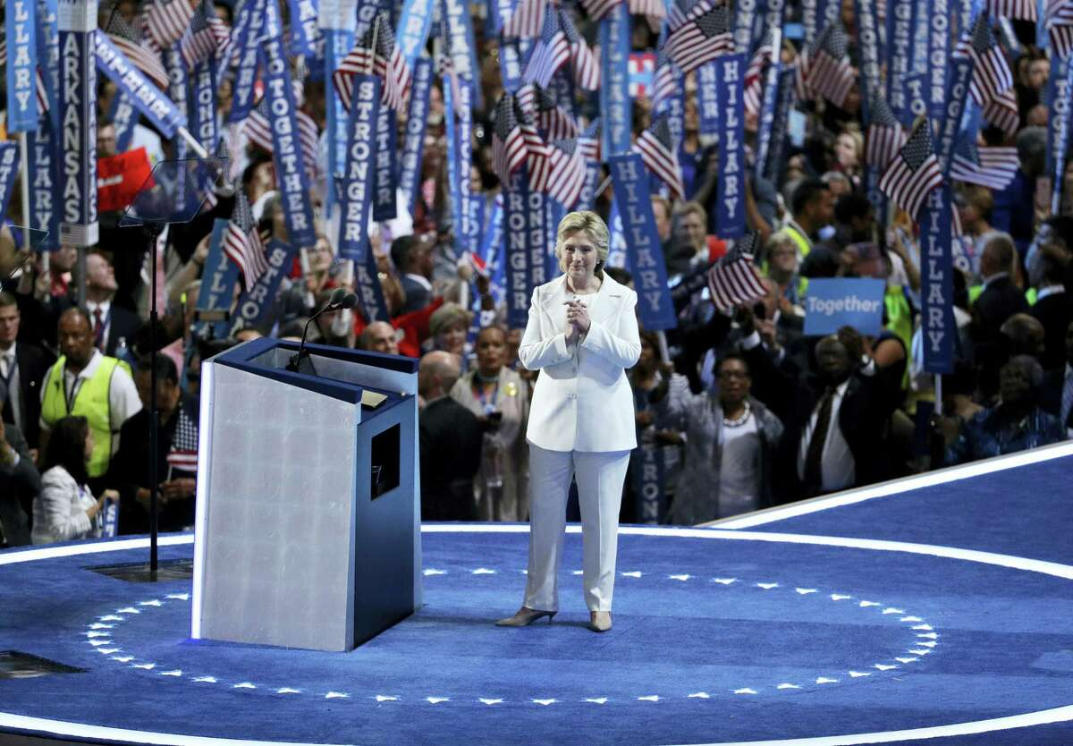 In this July 28 photo, Democratic presidential nominee Hillary Clinton reacts after speaking during the final day of the Democratic National Convention in Philadelphia. For eight summer nights, there were two starkly different visions of America at the Republican and Democratic political conventions.