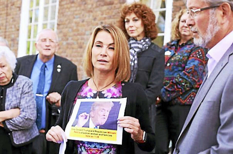 House Minority Leader Themis Klarides holds up a photo of the ad Photo: CT News Junkie Photo