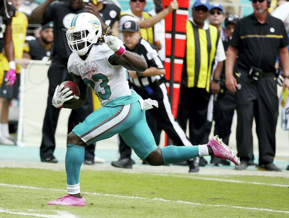 Dolphins running back Jay Ajayi has a chance to become the first NFL player to rush for 200 yards in three consecutive games when the Dolphins play the Jets. Photo: The Associated Press File Photo   / Copyright 2016 The Associated Press. All rights reserved.