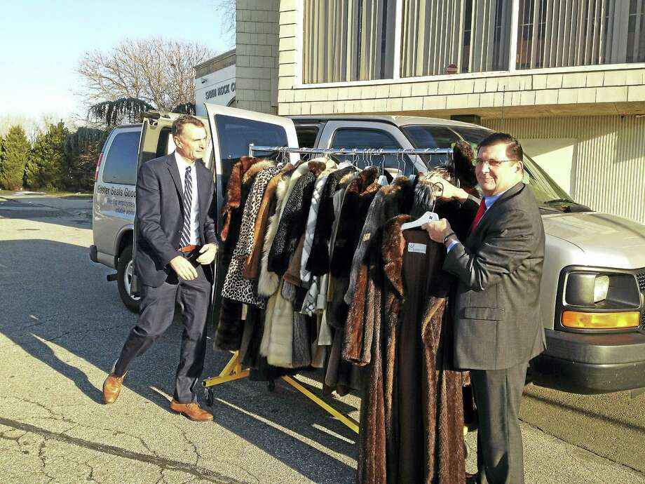 Easter Seals Goodwill New Haven, Connecticut CEO and former West Haven Mayor H. Richard Borer Jr., left, and West Haven Mayor Ed O'Brien, right, with 42 fur coats donated to the city by Tom Prezioso of Furs By Prezioso, Ltd. Photo: Mark Zaretsky — New Haven Register