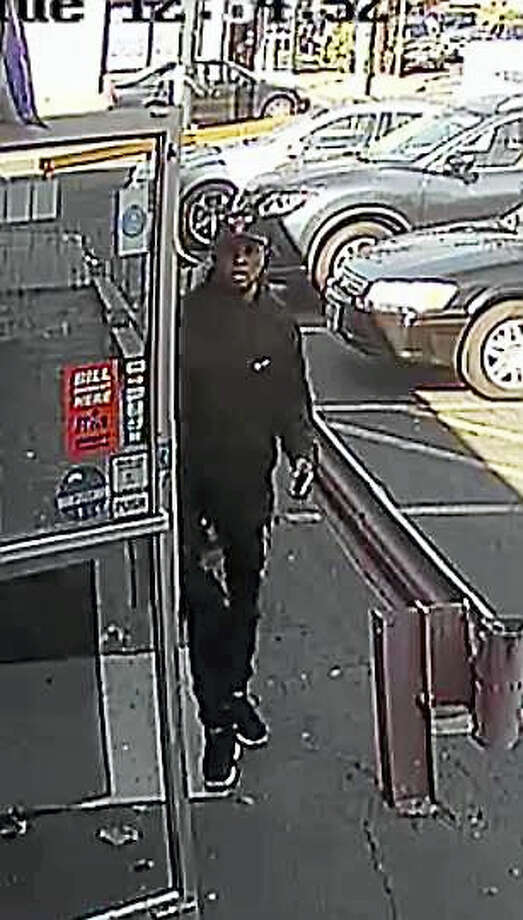 New Haven police are asking for the public's help in identifying this man they want to speak to in connection with the Oct. 18 fatal shooting of Ferry Street store owner Muhanad Jawad, 21. Photo: Police Surveillance Photo