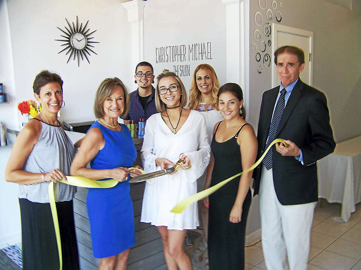 A CUT ABOVE: Christopher Michael The Salon, 148 Center St. in Wallingford, opened with a ribbon-cutting recently. The salon is a one stop destination for all hair care needs with services that include: design, gentleman's grooming, style and complimentary consultation prior to any appointment, according to a release. Celebrating the opening were, from left, Elizabeth Landow, owner, Wallingford Center Inc.; Dee Prior-Nesti, executive director of the Quinnipiac Chamber of Commerce; Christopher Merola; Deana Mazzeo, owner; Vanessa Milano, stylist; Shannon Mazzeo; and Mayor William Dickinson Jr.