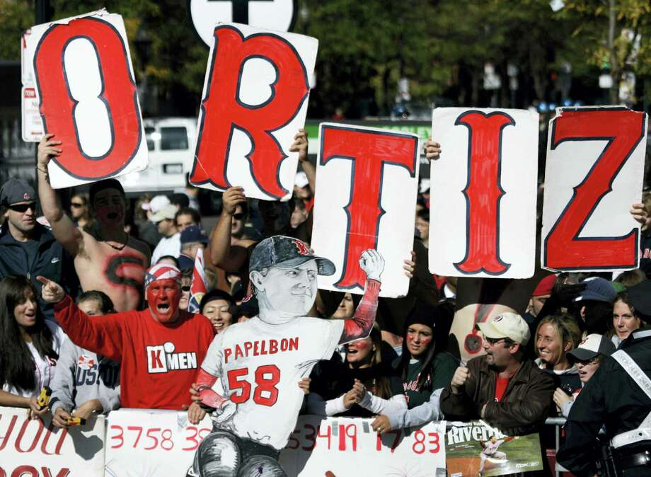 "Red Sox fans hold up letters that spell out ""ORTIZ"" for Red Sox slugger David Ortiz. Photo: The Associated Press File Photo   / AP2007"