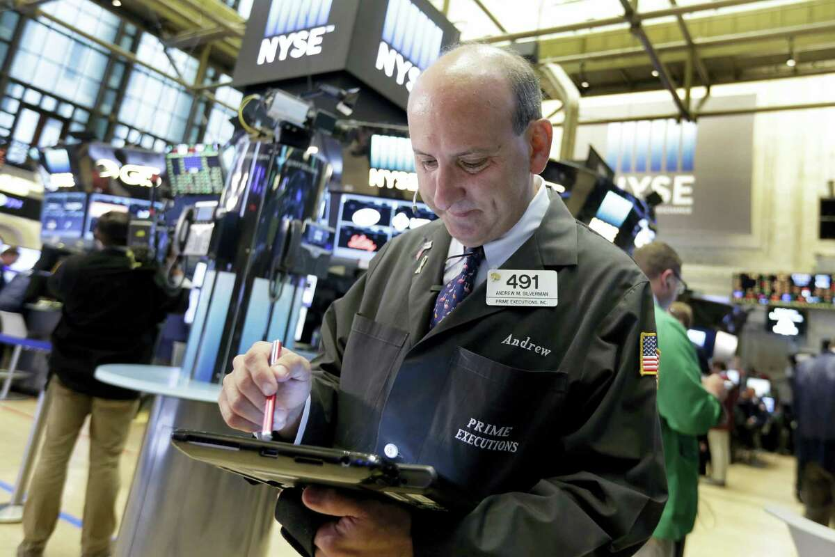 Trader Andrew Silverman works on the floor of the New York Stock Exchange Wednesday.