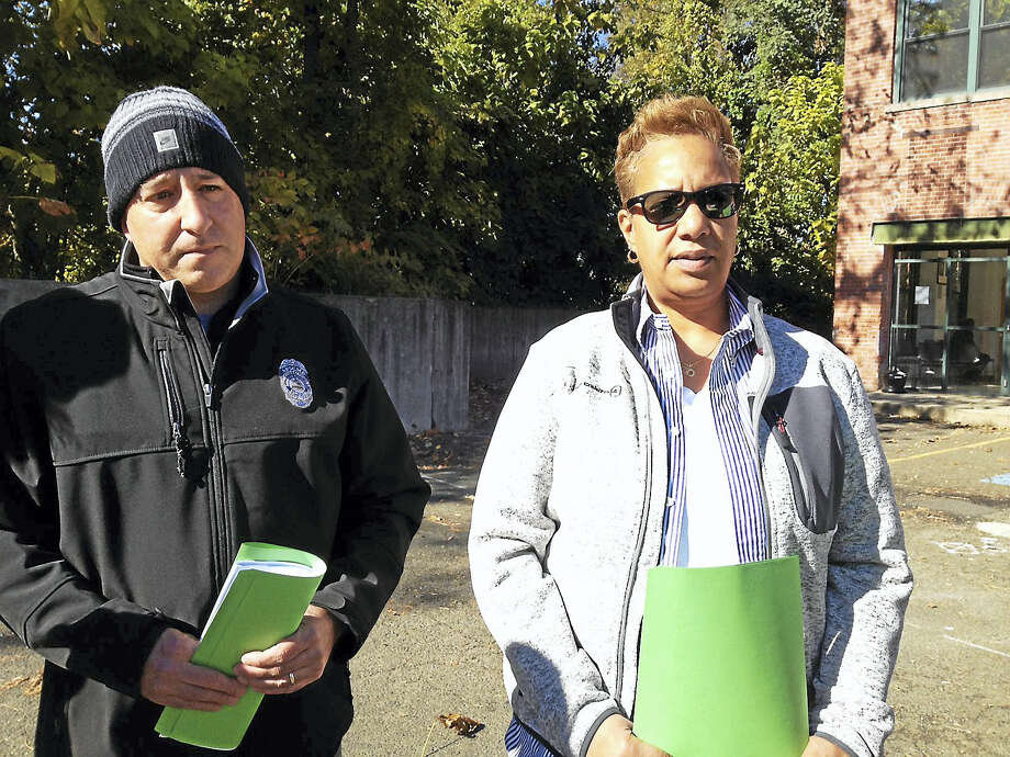 PHOTO BY MARY O'LEARY - NEW HAVEN REGISTER  Parole officers Mark Sarsfield and Paula Curry explain the physical problems at their offices at 50 Fitch St. which is behind them. Photo: Digital First Media