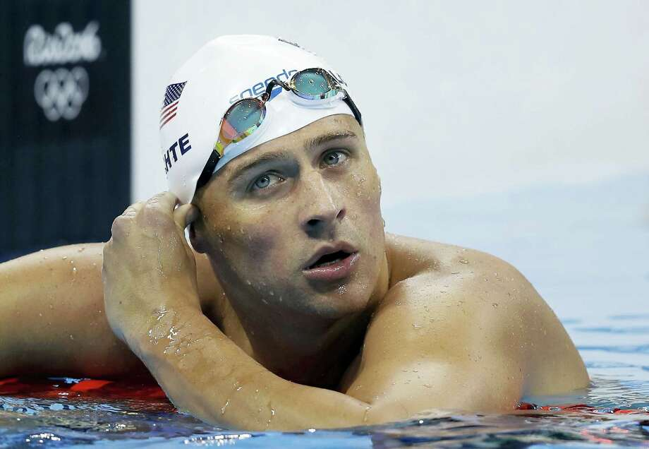 "In this Aug. 9, 2016 photo, United States' Ryan Lochte checks his time in a men's 4x200-meter freestyle heat during the swimming competitions at the 2016 Summer Olympics in Rio de Janeiro, Brazil. During an Aug. 30, 2016 appearance on ABC's ""Good Morning America,"" Lochte wouldn't say whether he'd return to Brazil to face charges of filing a false police report over an incident at a gas station during the Games. Photo: AP Photo/Michael Sohn, File   / Copyright 2016 The Associated Press. All rights reserved. This material may not be published, broadcast, rewritten or redistribu"
