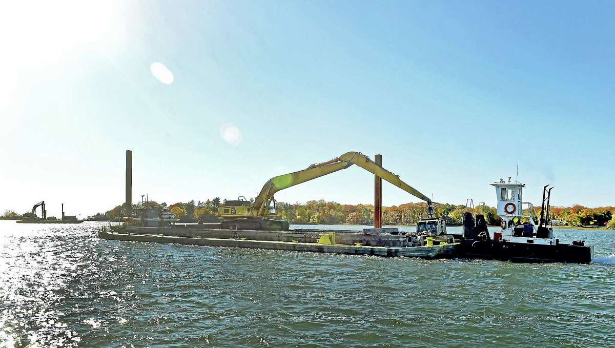 (Peter Hvizdak - New Haven Register)Twistah, a Patriot Marine Co. dredging vessel from Boston, motors out of the Mianus River in Riverside, Connecticut Friday, November 4, 2016 after a day of dredging near the Mianus River railroad bridge. The U.S. Army Corps of engineers is doing some maintenance dredging along a channel of the Mianus River. A similar dredging project will be completed at the lower end of the Housatonic River beginning next October, and the sands removed in that project will be relocated to Hammonasset State Beach to fill in parts of the beach have eroded.