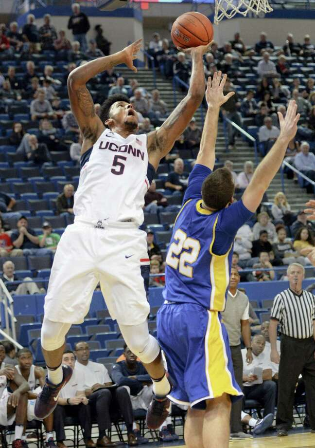 UConn's Vance Jackson shoots over New Haven's Tommy Hunt during the second half on Sunday. Photo: Stephen Dunn — The Associated Press   / FR171426 AP