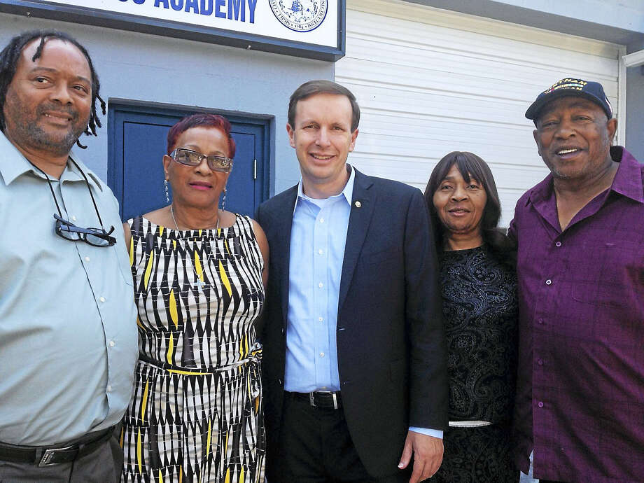 From left, Garry Monk, Olivia Monk Henderson, U.S. Sen. Chris Murphy, Helen Harper Wilson and Conley F. Monk Jr. outside Small Business Academy in New Haven. Photo: Mary O'leary - New Haven Register
