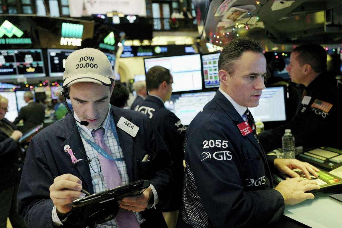 Traders work at the New York Stock Exchange Thursday in New York.