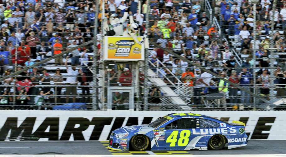 Jimmie Johnson crosses the finish line to win at Martinsville Speedway on Sunday. Photo: Steve Helber — The Associated Press   / Copyright 2016 The Associated Press. All rights reserved.