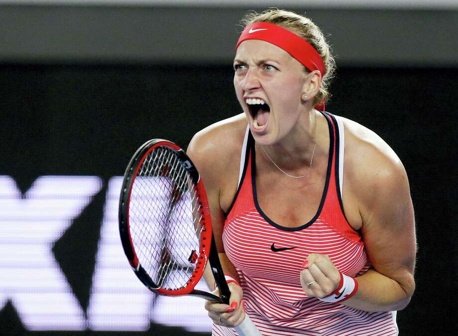Petra Kvitova of the Czech Republic clenches her left hand as she reacts after winning a point against Daria Gavrilova of Australia during their second round match at the Australian Open tennis championships in Melbourne, Australia. Two-time Wimbledon champion Petra Kvitova has been injured by a knife-wielding attacker at her home on Tuesday Dec. 20, 2016. The player's spokesman, Karel Tejkal, says Kvitova suffered a left hand injury and has been treated by doctors. Photo: AP Photo/Aaron Favila, File   / Copyright 2016 The Associated Press. All rights reserved.