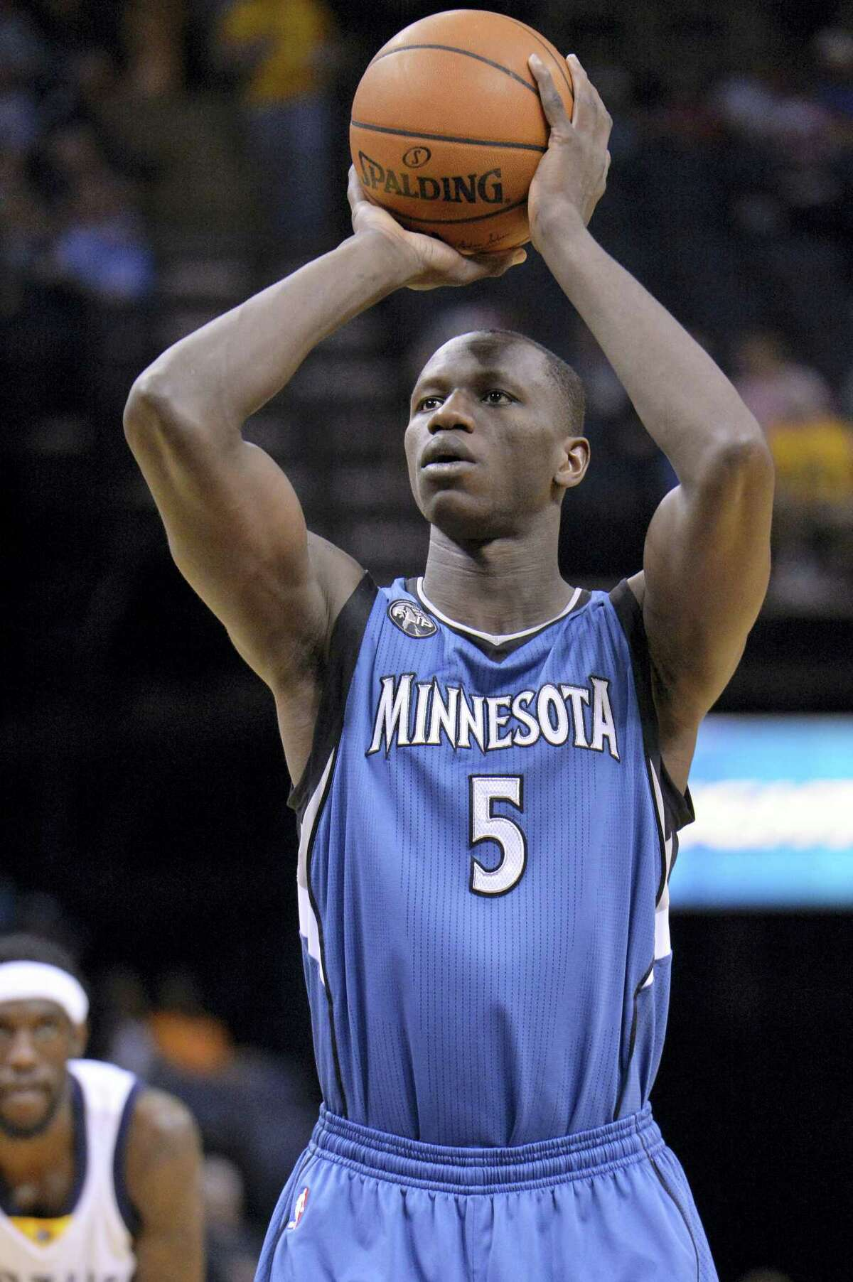 In this Wednesday, March 16, 2016 photo, Minnesota Timberwolves player Gorgui Dieng from Senegal plays in the first half of an NBA basketball game in Memphis, Tenn. The NBA will open an academy in Africa next year, its latest move to unearth talent from outside the United States and extend the league's reach into new territories.