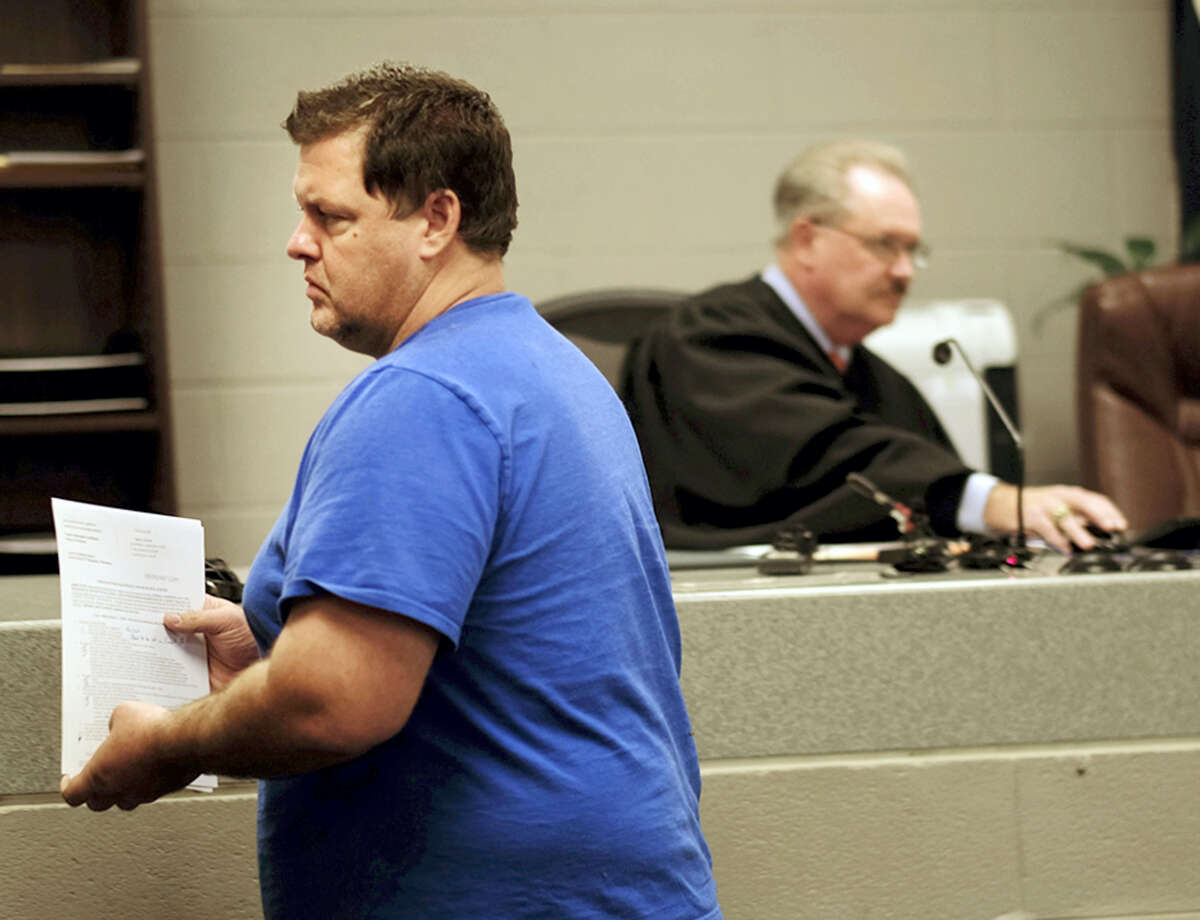 Todd Kohlhepp appears in a Spartanburg County magistrate courtroom, Friday, Nov. 4, 2016, in Spartanburg, S.C.. Kohlhepp, a 45-year-old registered sex offender with a previous kidnapping conviction, appeared at a bond hearing Friday on a kidnapping charge in connection to a woman being found chained inside a storage container on a property in Woodruff, S.C. More charges will be filed later, the prosecutor told the court.