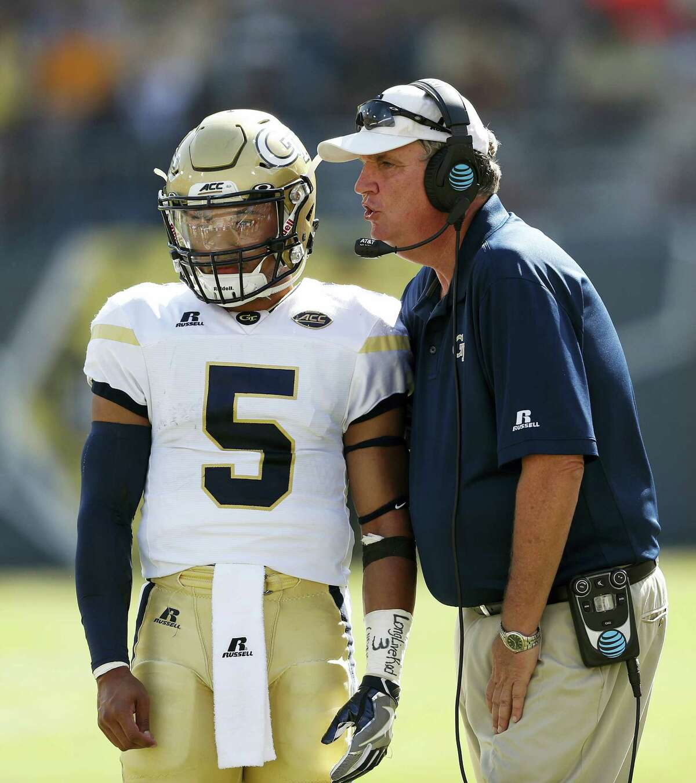Georgia Tech head coach Paul Johnson talks with quarterback Justin Thomas (5) in the second half of an NCAA college football game against Duke, Saturday, Oct. 29, 2016, in Atlanta. Georgia Tech won 38-35. (AP Photo/John Bazemore)