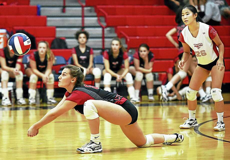 Cheshire junior Megan Kroqui (8) digs the ball against Foran, in a 3-1 win Wednesday at Foran High School in Milford. Photo: Catherine Avalone — New Haven Register   / New Haven RegisterThe Middletown Press