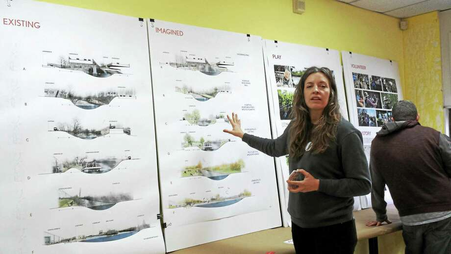 Eliza Valk, a designer of the Mill River Trail, shows off what the trail is intended to look like after construction next year. (Anna Bisaro - New Haven Register) Photo: Digital First Media