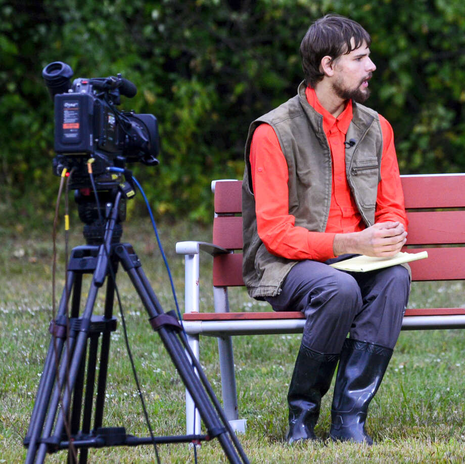 Nathan Carman, rescued from a life raft after a fishing trip, talks to an ABC news reporter in Brattleboro, Vermont, Wednesday. Carman, a 22-year-old former Middletown man rescued from a life raft after a fishing trip that left his Linda Carman, 54, of Middletown, missing and presumed dead. He had been a suspect in the still-unsolved 2013 slaying of his rich grandfather, adding to the multitude of questions swirling around him and what happened at sea. Photo: Kristopher Radder — The Brattleboro Reformer Via AP    / The Brattleboro Reformer