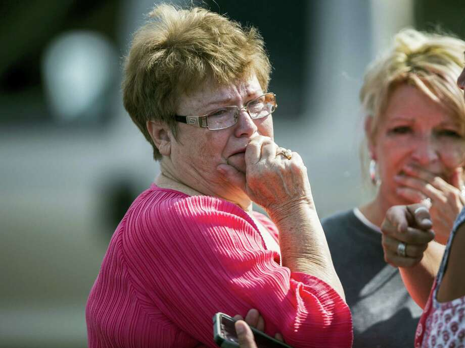 A woman reacts following a shooting at Townville Elementary in Townville Wednesday, Sept. 28, 2016. A teenager killed his father at his home Wednesday before going to the nearby elementary school and opening fire with a handgun, wounding two students and a teacher, authorities said. Photo: Katie McLean/The Independent-Mail Via AP    / The Independent-Mail