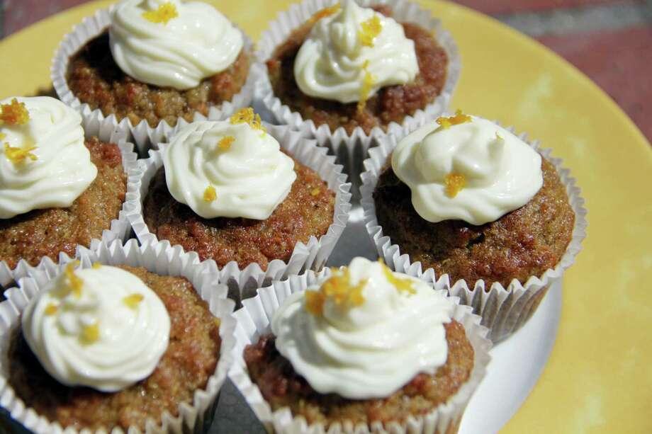 Mini quinoa carrot cakes can be a snack or a breakfast. Photo: Melissa D'Arabian — The Associated Press   / Melissa d'Arabian