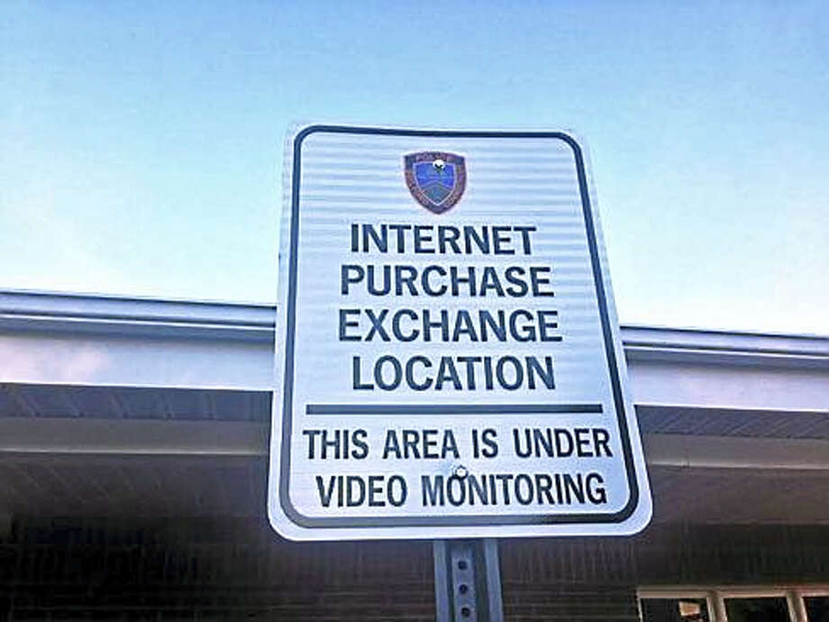 Sign in the Guilford Police Department parking lot noting it is an internet purchase exchange location Photo: Jack Kramer — CT News Junkie