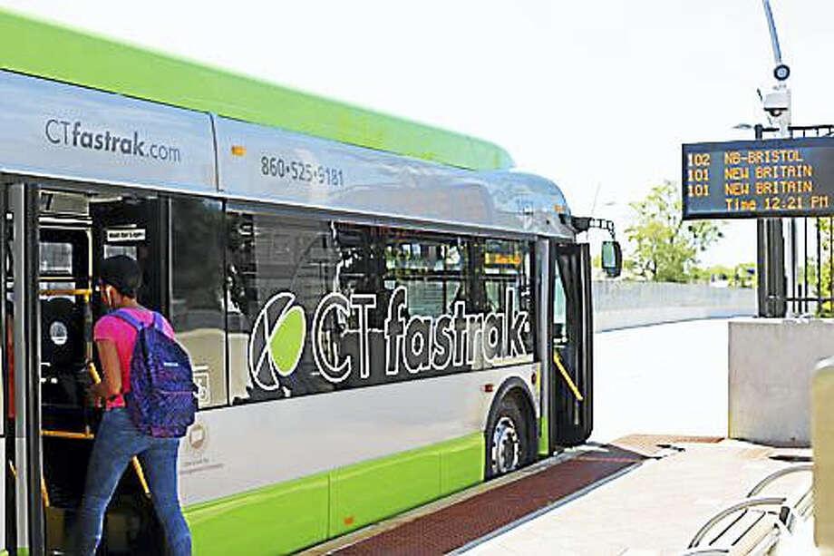 Passenger boarding CTfastrak at Parkville Station in Hartford Photo: Christine Stuart Photo