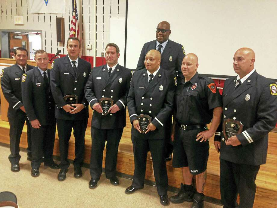New Haven firefighters were recognized Tuesday for their heroic actions during two fire rescues. Photo: Juliemar Ortiz — New Haven Register