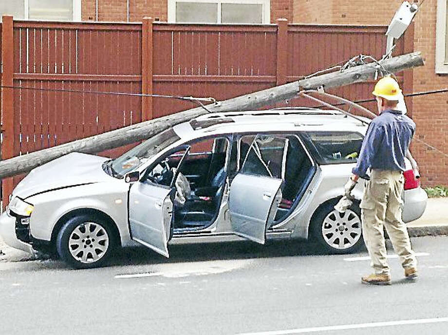 A utility pole was damaged and the road was reportedly shut down at the intersection of South Frontage and York streets Thursday in New Haven. Photo: Juliemar Ortiz — New Haven Register