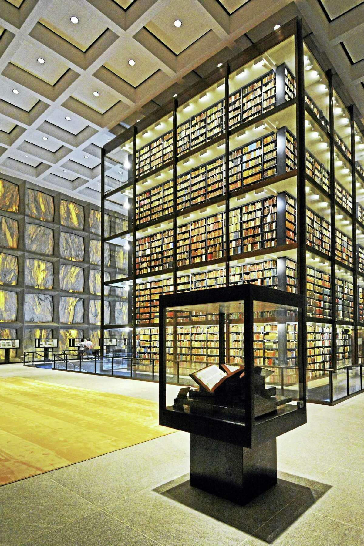 Restored and renovated Beinecke Rare Book and Manuscript Library, with exhibition cases surrounding the stacks and translucent marble wall panels.