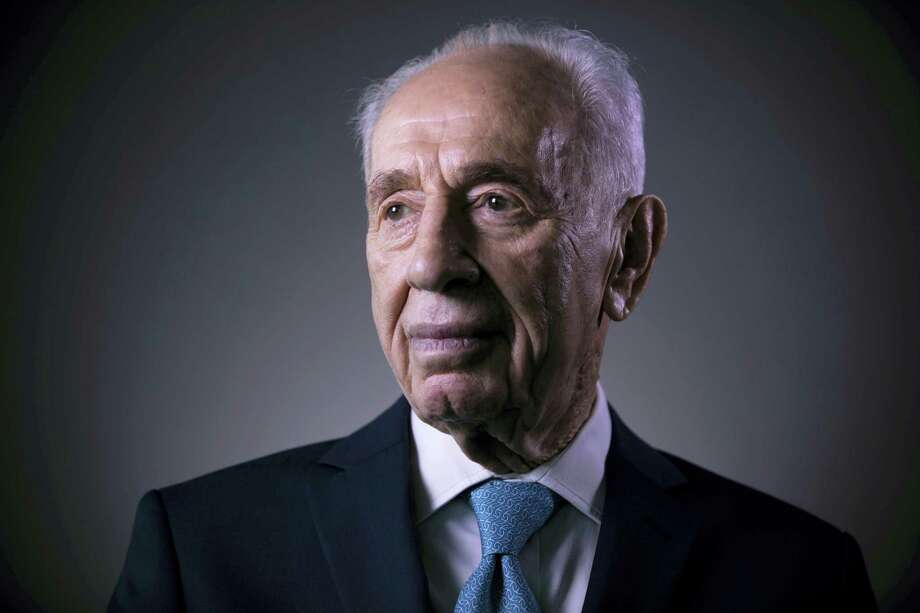 In this Monday, Feb. 8, 2016  file photo, Israel's former President Shimon Peres poses for a portrait at the Peres Center for Peace in Jaffa, Israel. Israel's Foreign Ministry says a long list of world leaders will attend Shimon Peres' funeral on Friday. Spokesman Emmanuel Nahshon said Wednesday that President Obama, Bill and Hillary Clinton, Pope Francis, Prince Charles and Canadian Prime Minister Justin Trudeau are all expected. (AP Photo/Oded Balilty, File) Photo: AP / Copyright 2016 The Associated Press. All rights reserved.