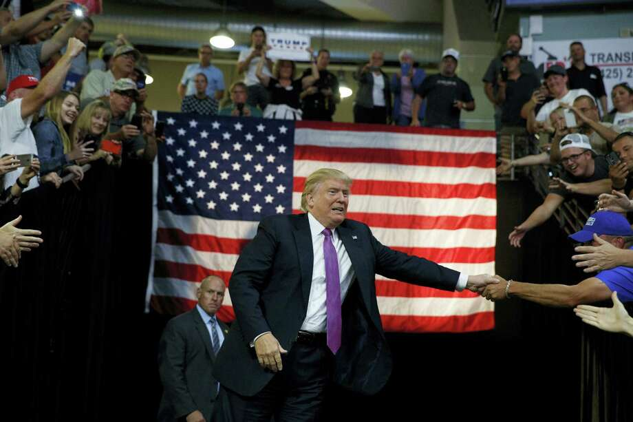 Republican presidential candidate Donald Trump shakes hands as he arrives to a campaign rally at Xfinity Arena of Everett, Tuesday, Aug. 30, 2016, in Everett, Wash. Photo: AP Photo — Evan Vucci / Copyright 2016 The Associated Press. All rights reserved.