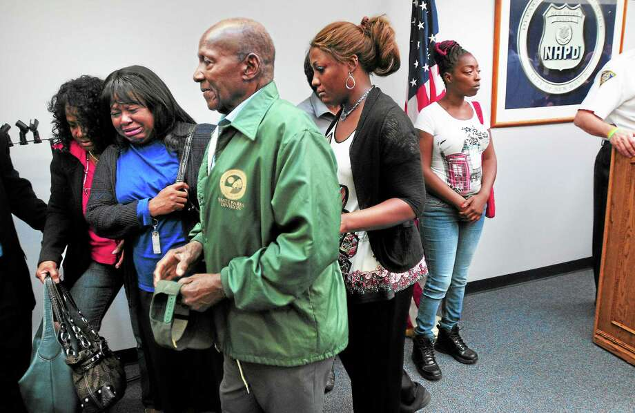 John Stevenson, center left, father of Anthony Stevenson, walks with his family from a press conference at the New Haven Police Department announcing the arrest of Semmion Watson in the slaying of Anthony Stevenson in 2013. At right is Anthony Stevenson's wife, Monique. Photo: Arnold Gold — New Haven Register