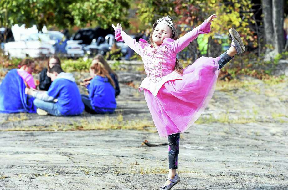 Keili Brophy, 8, of West Haven dances to the music of a DJ during the Fall Festival in the courtyard of West Haven High School on Saturday. She was at the event with her mother and sisters. Photo: Arnold Gold — New Haven Register