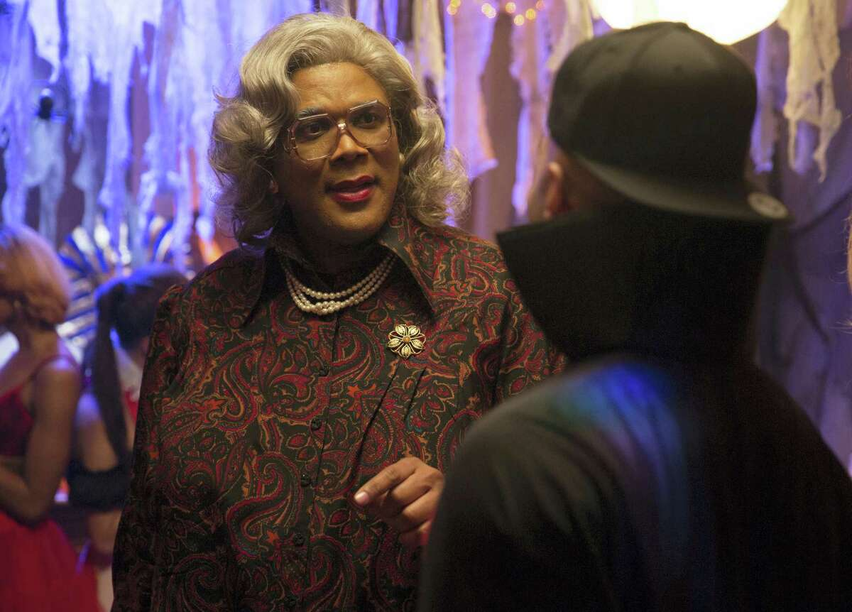 """In this image released by Lionsgate, Tyler Perry portrays Madea in a scene from, """"Tyler Perry's Boo! A Madea Halloween."""" Perry's latest Madea movie remained number one for the second straight week, topping the North American box office with an estimated $16.6 million."""