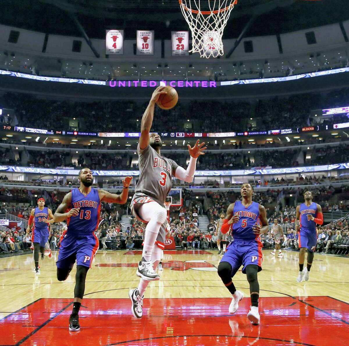 Chicago Bulls' Dwyane Wade (3) scores past Detroit Pistons' Marcus Morris (13) and Kentavious Caldwell-Pope during the first half of an NBA basketball game Monday, Dec. 19, 2016 in Chicago.