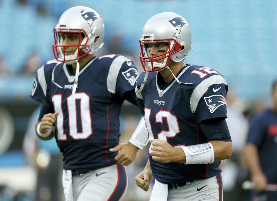 New England Patriots quarterbacks Tom Brady (12) and Jimmy Garoppolo. Photo: Bob Leverone — The Associated Press   / FR170480 AP