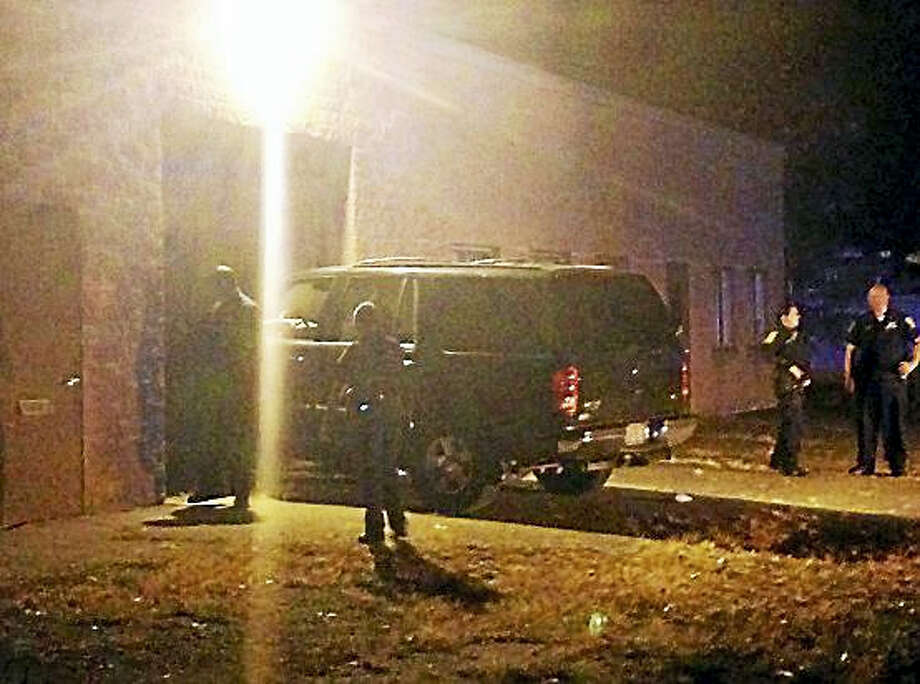 A man was transported to the hospital after crashing his SUV into a building in Hamden. Photo: Juliemar Ortiz — New Haven Register