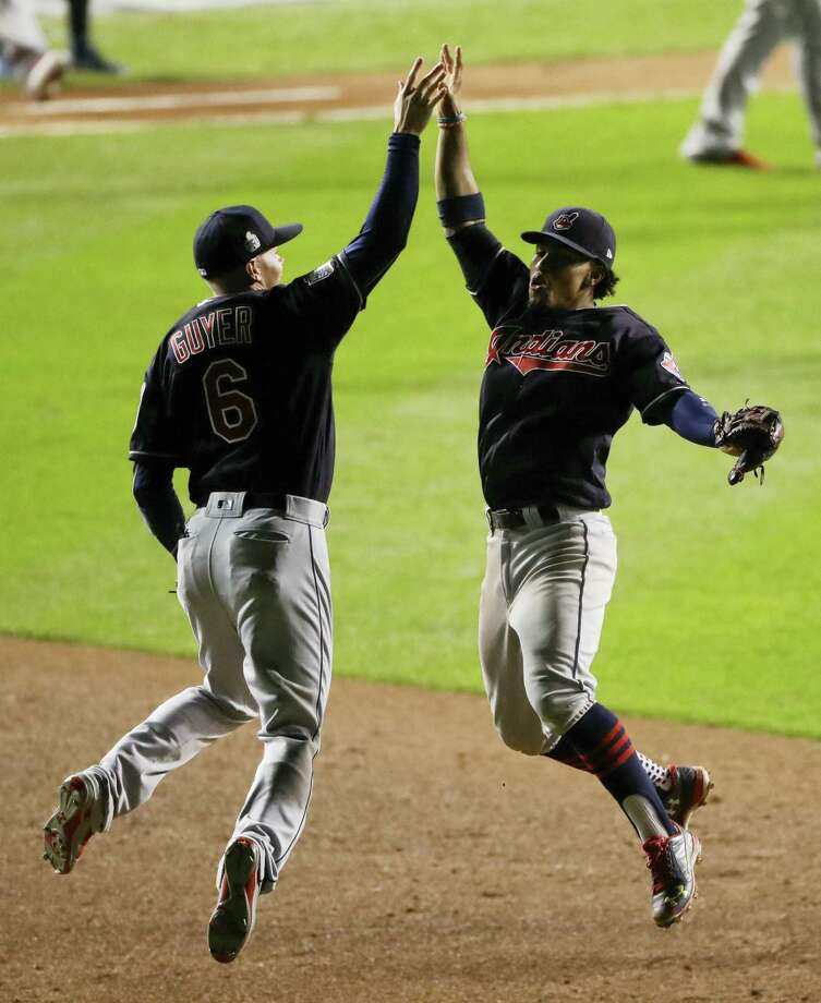 Cleveland Indians shortstop Francisco Lindor, right, and left fielder Brandon Guyer celebrate after their win in Game 3 on Friday. Photo: The Associated Press    / Copyright 2016 The Associated Press. All rights reserved.