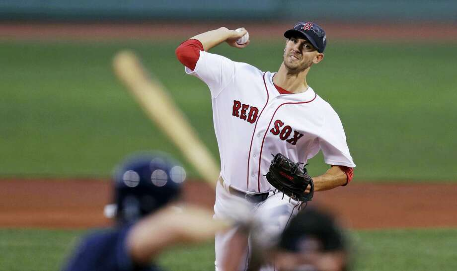 Red Sox starting pitcher Rick Porcello delivers against the Rays on Monday. Photo: Charles Krupa — The Associated Press   / AP