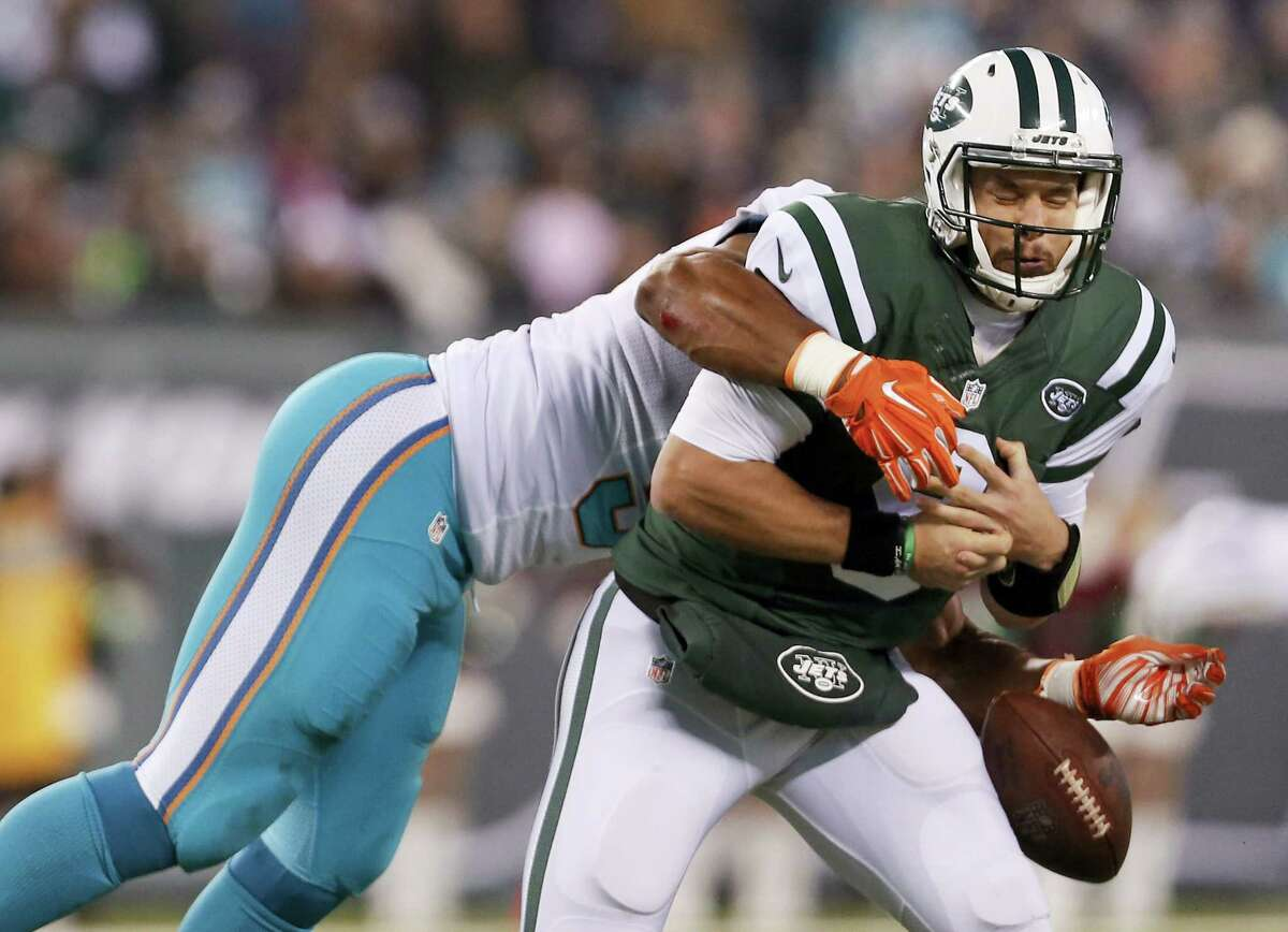 New York Jets quarterback Bryce Petty (9) fumbles the ball as he is sacked by Miami Dolphins defensive end Cameron Wake (91) during the first quarter Saturday in East Rutherford, N.J.