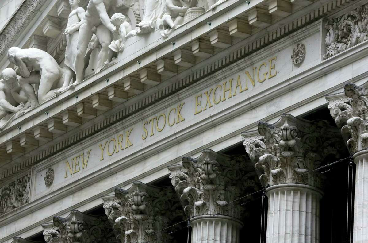 FILE - This Oct. 2, 2014, file photo shows the facade of the New York Stock Exchange. Stock markets around the world are ending the week on a flat note after the Bank of Japan disappointed investors Friday, July 29, 2016, with a smaller than anticipated stimulus. However, the yen surged following Friday's decision.