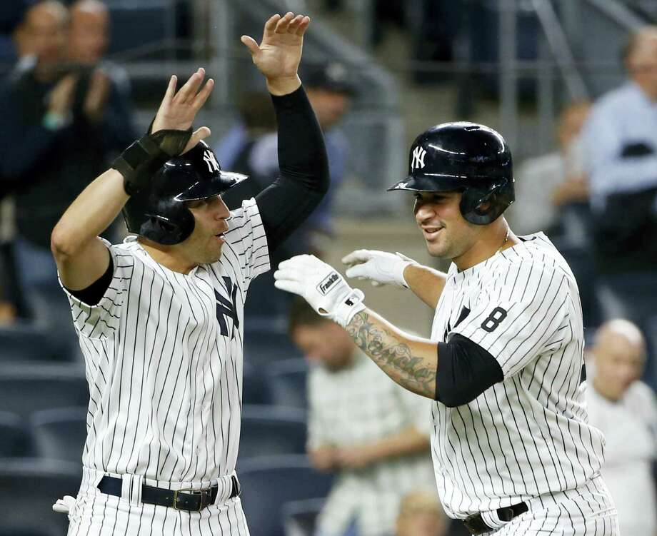 New York Yankees' Jacoby Ellsbury, left, celebrates with Gary Sanchez, right, after scoring on Sanchez's first-inning, two-run home run in a baseball game against the Boston Red Sox in New York, Tuesday, Sept. 27, 2016. (AP Photo/Kathy Willens) Photo: AP / Copyright 2016 The Associated Press. All rights reserved.