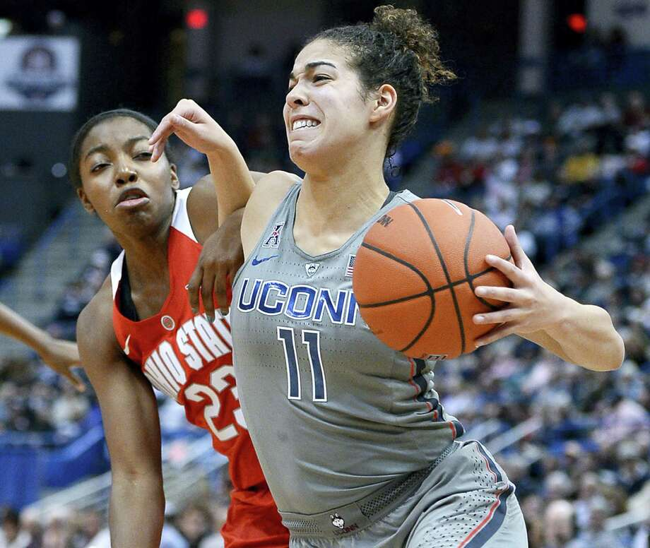 Connecticut's Kia Nurse, right, tangles with Ohio State's Kiara Lewis, left, in the second half Monday in Hartford. Photo: Jessica Hill — The Associated Press   / AP2016