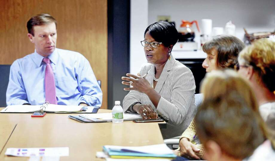 U.S. Sen. Chris Murphy, left, listens to Miriam Delphin-Rittmon, center, commissioner of the Department of Mental Health and Addiction Services, speaks at a roundtable discussion about the opioid epidemic at BHcare in Ansonia Friday. Photo: Arnold Gold — New Haven Register