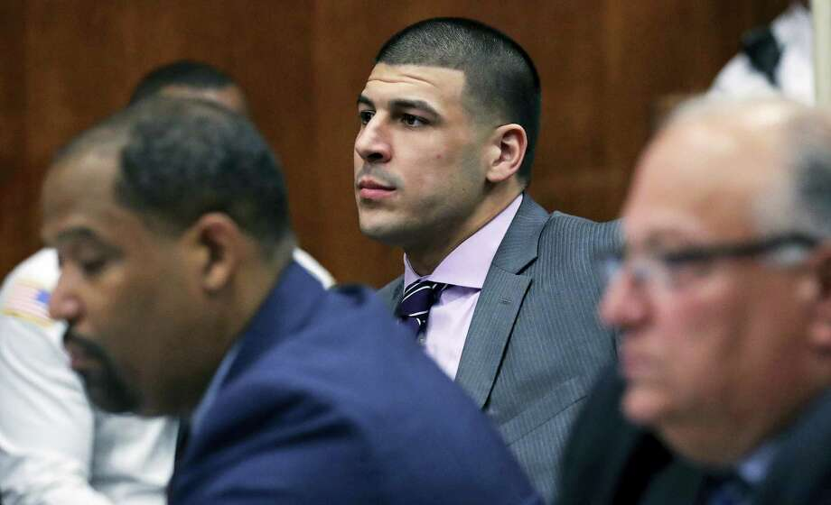 In this Wednesday, Dec. 7, 2016 photo, former New England Patriots NFL football player Aaron Hernandez, center, sits with his defense team during a court appearance at Suffolk Superior Court in Boston. Hernandez is due in court as a judge hears arguments on motions filed by his lawyers in his upcoming double murder trial. Photo: AP Photo/Charles Krupa, File   / AP